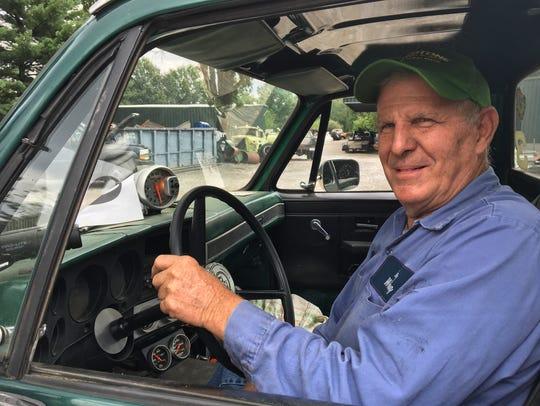 Bob Flaig revs up his green Chevrolet truck souped