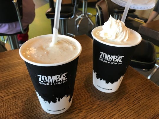 A Human Centipeach shake (vanilla ice cream, peach purée, white cake batter and graham cracker crumbs) and a coconut cream pie shake at Zombie Burger + Drink Lab in Des Moines.