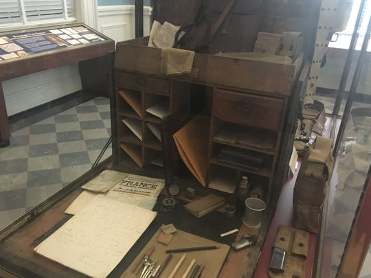 A desk from one of the Rainbow Division soldiers from Alabama is located in the ADAH.