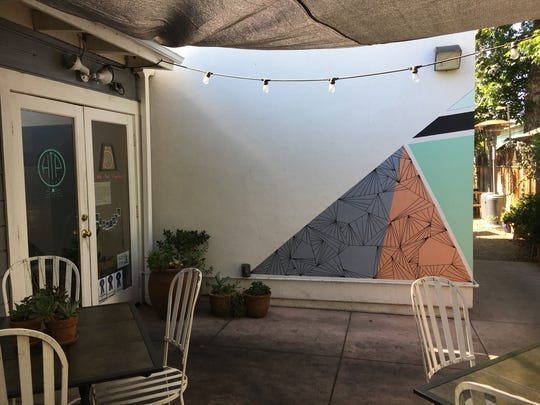 At Hip Vegan Cafe's original location in Ojai, most of the seating was found on a sheltered patio near the front door, shown here, and at picnic tables at the front of the building. The restaurant is moving to a new address several blocks away.