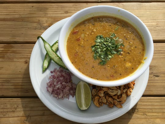 "Popular menu items at Hip Vegan Cafe in Ojai included the ""ashram lunch,"" featuring dal over brown rice and, on the side, add-your-own peppers, minced red onion, a lime wedge and chili-dusted cashews."