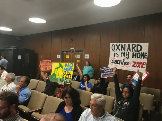 Protestors of proposed oil wells near Oxnard show their
