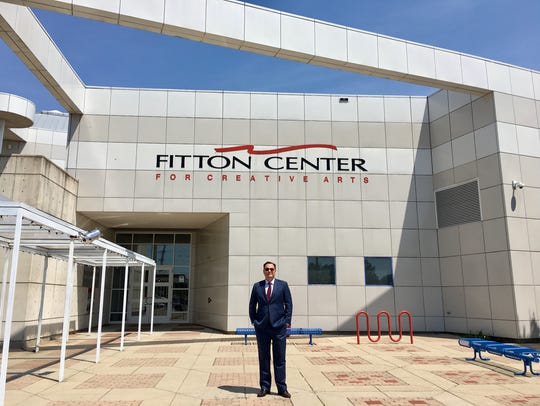 Ian MacKenzie-Thurley stands outside the Fitton Center