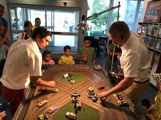 Slot car races were part of the fun Monday as the library