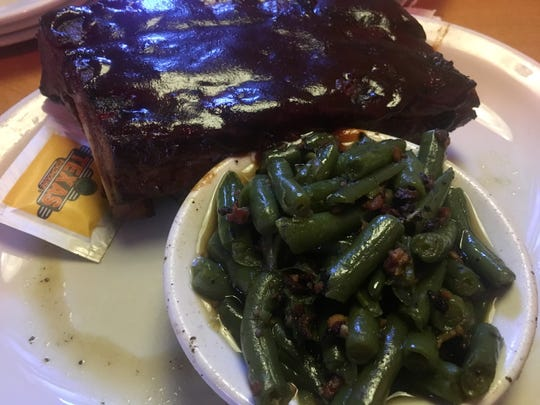 A half-order of ribs ($14.99) is served alongside a