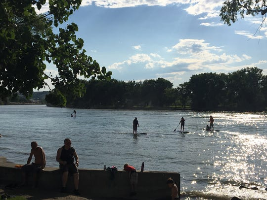 Attendees enjoy some paddleboarding during a 2016 Music