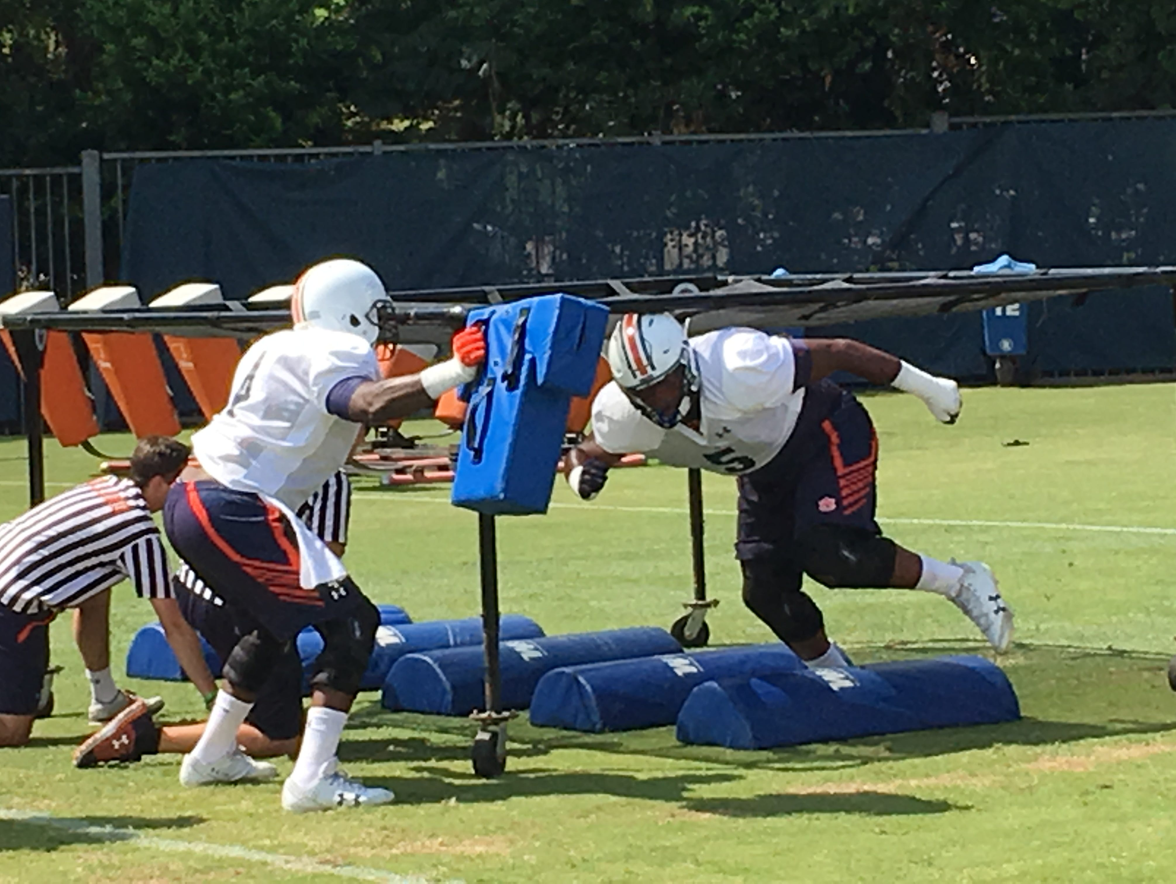 Auburn sophomore defensive lineman Derrick Brown going through a drill at preseason practice on Aug. 2, 2017.