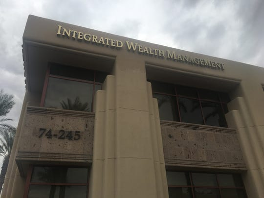 Integrated Wealth Management's name still appears on