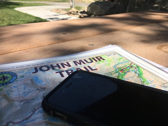 A map of the John Muir Trail on a picnic table in Bishop,