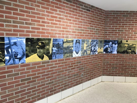 The entrance of SC4 Fieldhouse features photos of prominent SC4 athletes.
