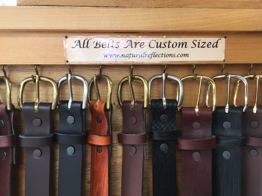 Belts hang on display in Conrad Dalrymple's tent at Park Ave Fest. He has participated in the festival since its inaugural year in 1976.