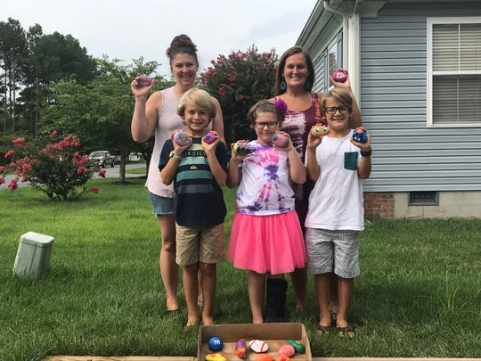 From left to right, Stephanie Koval, Jonah DeVito, Olivia Koval, Aubrey Sizemore and Zane DeVito proudly display the painted rocks they've been dispersing around their community in Ocean Pines.