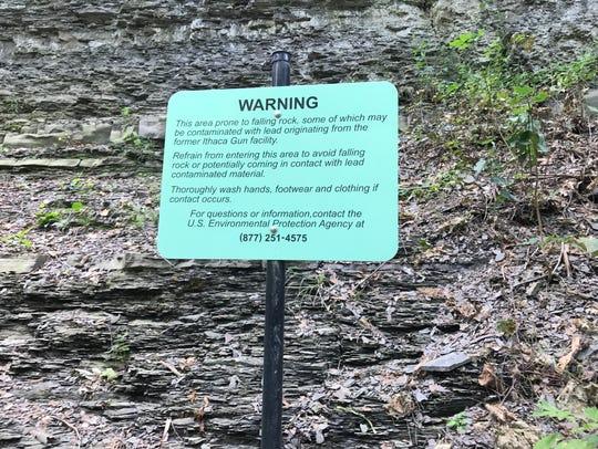 A warning sign at Ithaca Falls warns of loose and falling