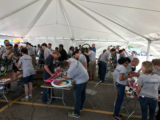 Some 300 Gale employees teamed up to build 50 bikes