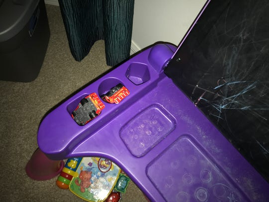 Isabella's two Lightning McQueen toy cars were found hidden beneath the tabletop of an electronic toy at her grandparents' condo.
