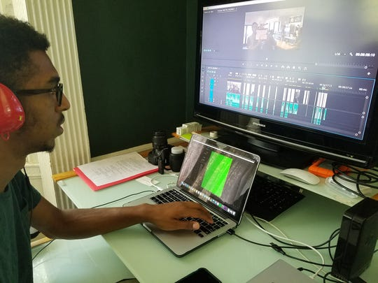"""Heroin(e)"" Co-director Isaiah Mackson edits the film that his father, Lamar, produced and for which, his brother, Kalani, was director of photography in the Plainfield home they share."