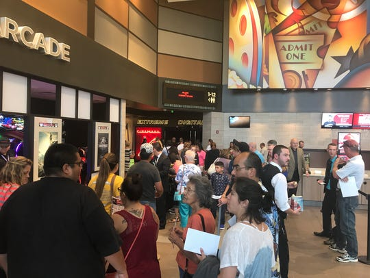 A crowd gathers to enter Cinemark's new theater for