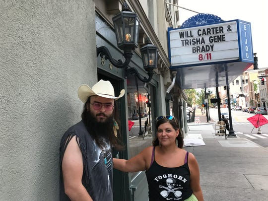 Will Carter and Trisha Gene Brady stand outside of the Bijou Theatre prior to their upcoming show.