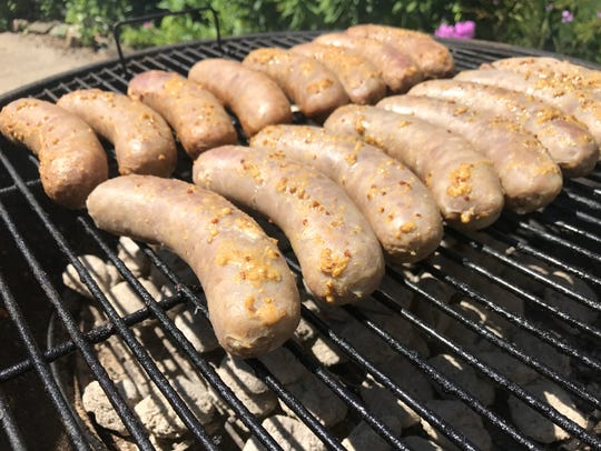 After a soak and short boil in a beer mixture, bratwurst