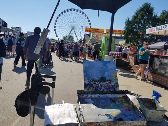 "Artist Judith Reidy painted the WonderFair Wheel in both day and night light for her entries in the Wisconsin State Fair's ""Plein Air at the Fair"" contest."