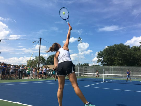 Port Huron Northern junior Sydney Sepsey serves during an exhibition match on the new Port Huron Northern tennis courts.