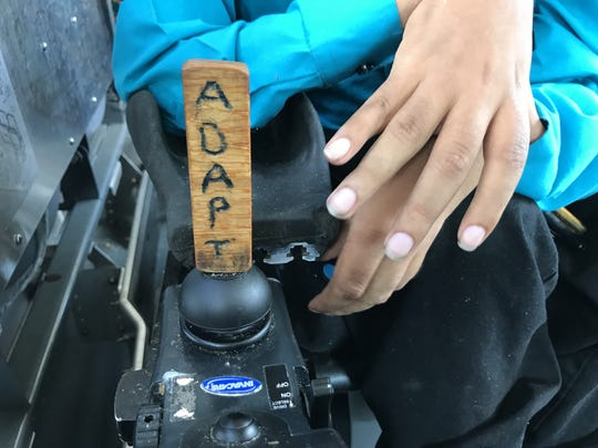 Jensen Caraballo is involved with ADAPT, a national grassroots organization for disability rights activists who engage in nonviolent direct action to raise awareness of issues affecting people with disabilities. He has decorated his power wheelchair with the name of the organization.
