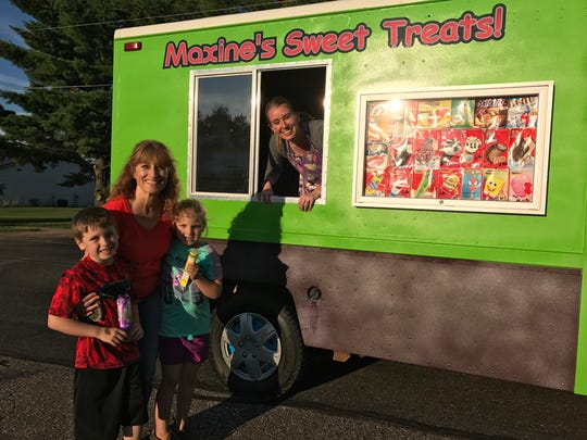 Maggie Smazal took her grandchildren, Jaxon and Halle, to get ice cream from Maxine's Sweet Treats, owned by Maxine Kremer, Aug. 8, 2017, in Pittsville.