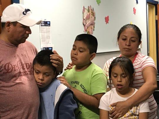 Jose Estrada Lopez of Fairview with his family. Estrada