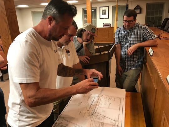 Pillar Design Studios President Brad Siedlacki, Pequannock Township Manager Dave Hollberg and skateboard park committee members, Jordan Galliano and Steve Connolly take a gander at skateboard park plans Wednesday at Pequannock's municipal building.