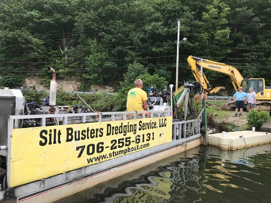 "Mark Johnson's ""stumpboat"" sits on the shores of Greenwood Lake before moving out to remove hazardous stumps rooted to the lakebed."