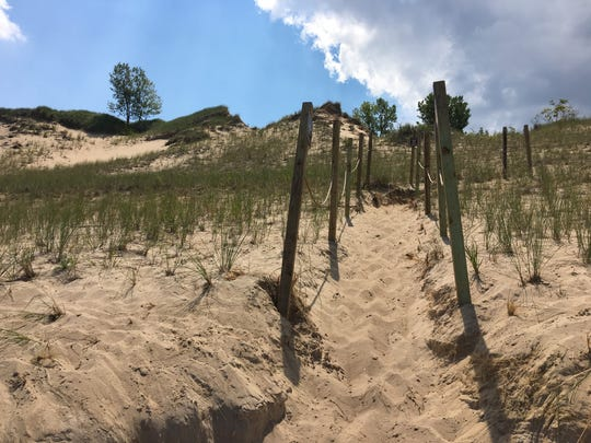 A roped-fence path marks the way around Mount Baldy to the parking lot Aug. 1, 2017 after dune access was closed because of dangerous holes at Indiana Dunes National Lakeshore.
