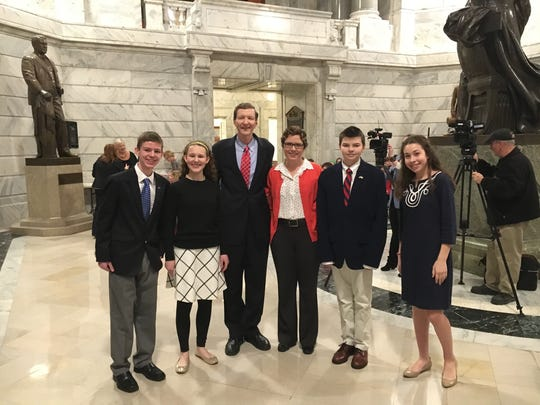 Students Alex Young (far left), Elizabeth George, Charlie Gardner and Emma Kate Watts-Roy (far right) pose with Rep. Jim Wayne and teacher Alison Milby in the Capitol Rotunda in February 2017. The students penned a bill ending corporal punishment in Kentucky schools.