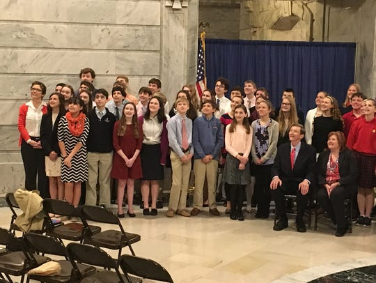 Students pose for a photo in the Capitol Rotunda after