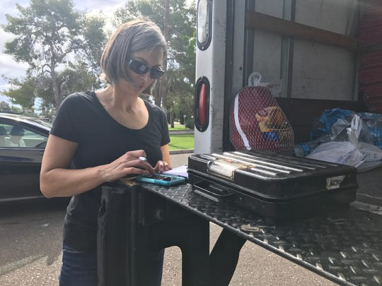 Heidi Heister, a volunteer with the Tempe Community Action Agency, weighed all of the food donations throughout the morning on Aug. 12, 2017.