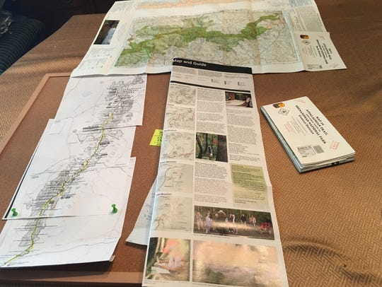 Appalachian Trail maps displayed on a table in Jan