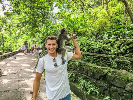 Huempfner is pictured with a newfound friend in Bali.
