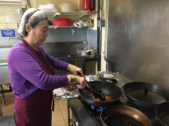 Chol Hauschel fries up some spicy pork at The Korean