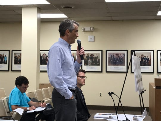 Timothy Bray presents his plans for a subdivision at Claremont Avenue and Willard Place to the Montclair Planning Board on Monday, Aug. 14. Seated to his left is architect Erik Shultz.