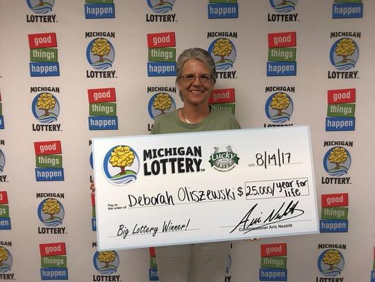 Deborah Oliszewski won $25,000 a year playing the Michigan