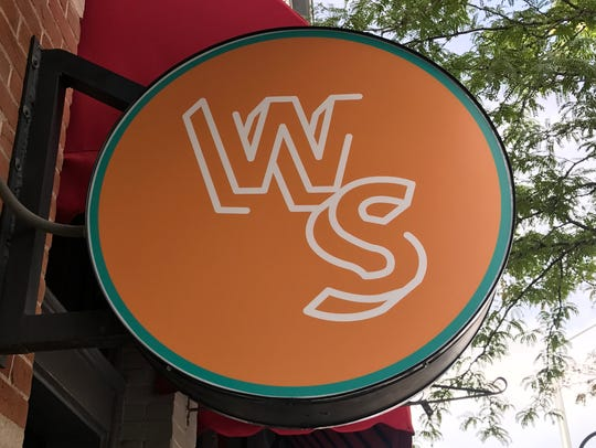 The sign for Wasted Space, a new bar in Fort Collins.