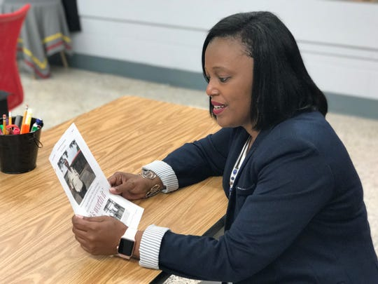 Hadnot-Hayes Principal Shannon Carmouche talks about the impact George Williams had as a school resource officer, while holding a copy of a Town Talk article Williams was featured in last month.