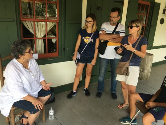 Becca Begnaud (left) speaks with a French family about