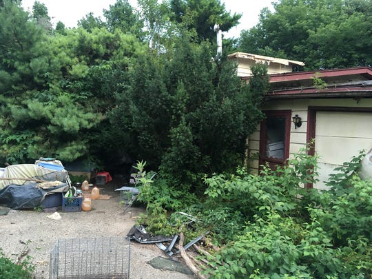 House on south side of Washington Island, which was home to dozens of feral cats. Door County condemned the house and  it was torn down Thursday, Aug. 17, 2017.