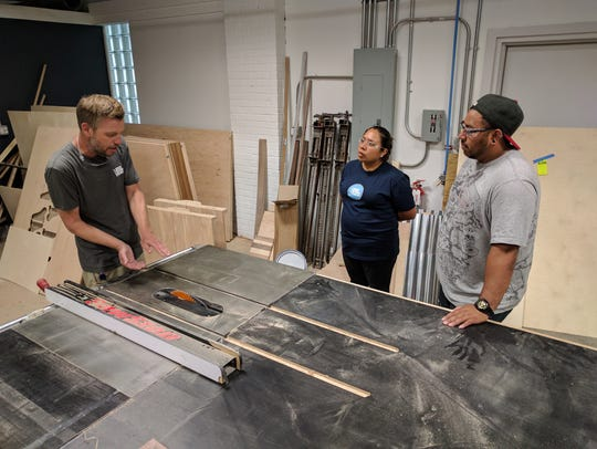 Monica Lopez, center, learns to use shop tools at Wilmington's