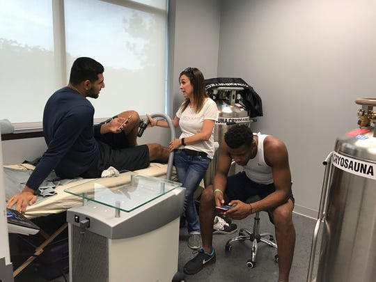 Kerem Kanter and Paul Scruggs, both members of the 2017-18 Xavier men's basketball team, receive cryotherapy spot treatment to help accelerate healing.
