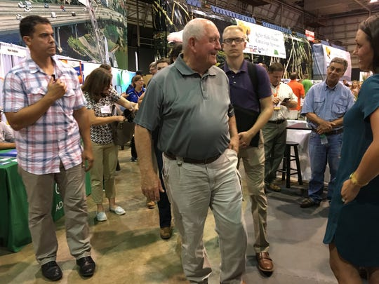U.S. Agriculture Secretary Sonny Perdue meets people attending the Citrus Expo Wednesday in North Fort Myers, Fla., in 2017.