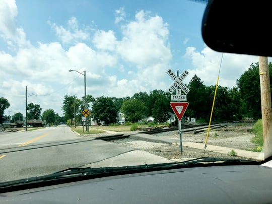 A yield sign at a railroad crossing on Napoleon Street
