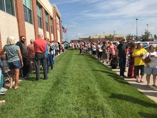 More than 700 people lined up outside Hy-Vee Wednesday morning, hoping to buy eclipse glasses. The store received an order of 2,800 and sold out quickly.