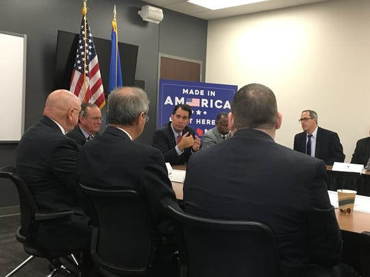 Gov. Scott Walker talks with government, business and education leaders from across the state during an educational round table Wednesday at Northeast Wisconsin Technical College. The discussion focused on the economic impact that would come from bringing Foxconn Technology Group to Wisconsin.