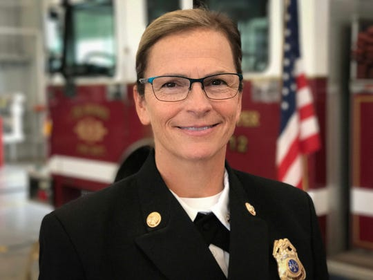Des Moines firefighter Amy Montgomery was promoted to district fire chief during a ceremony at the Des Moines Fire Department Administration Building in Des Moines on Thursday, Aug. 17, 2017. Montgomery is the first female chief officer in the department's history.